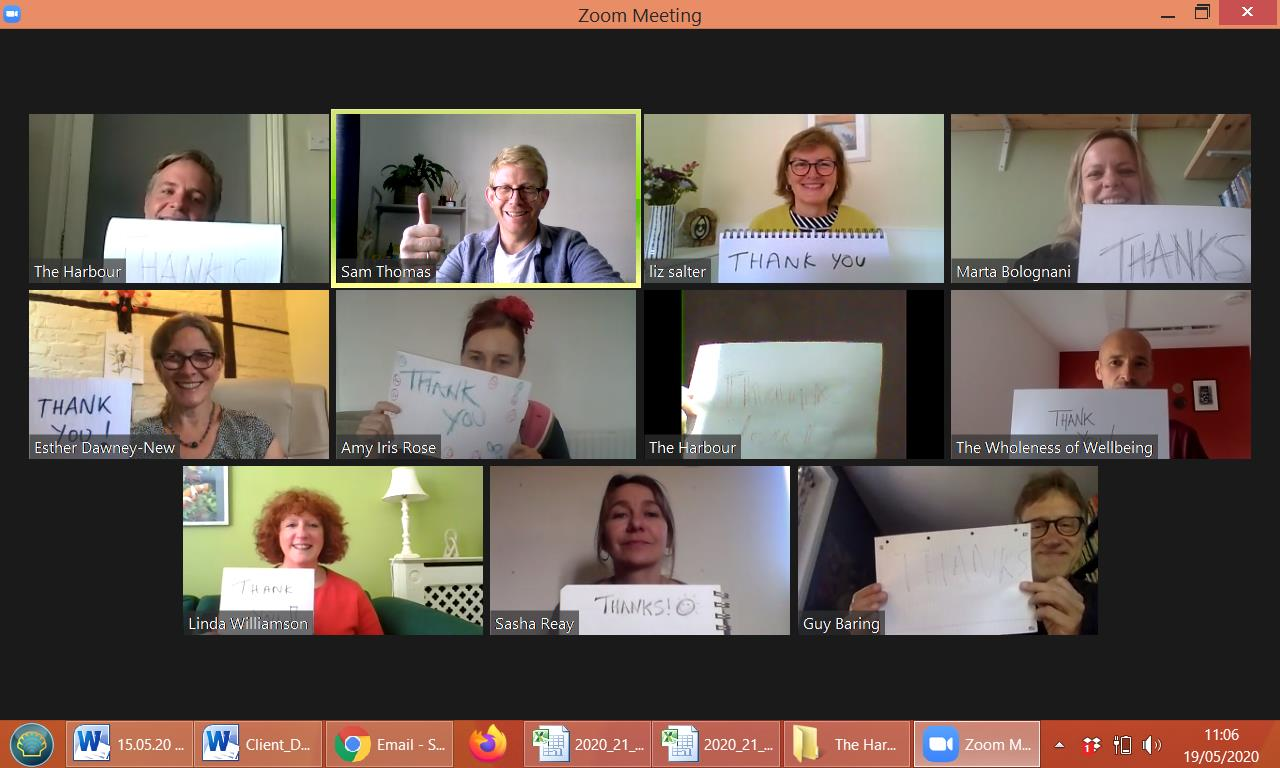 The Harbour therapists in zoom meeting with thank you signs