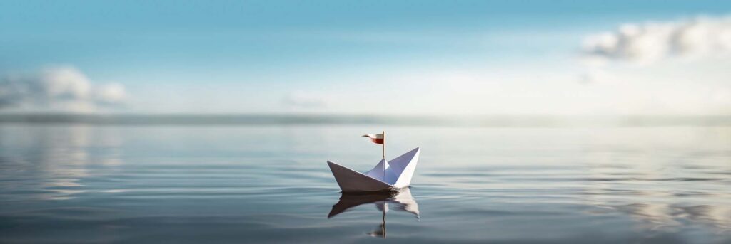 paper boat on calm water